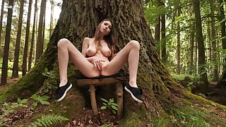Big-chested Milla rubs her juicy sweet center yon the woods