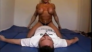 Denuded feminine bodybuilder dominates premier danseur with scissors, facesits, ass smothers and breast