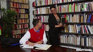 Stuffed-shirt librarian Katana Kombat lets her guard down with a young buck