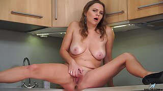 Seductive wife finger fucks pussy concerning solo kitchen stance