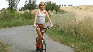Hungarian teen - by bike in the fields