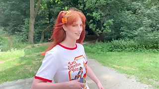 Redhead teen Alex Harper thither pigtails does a photoshoot ing�nue