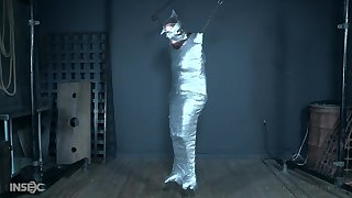 Brunette teen resultant girl Stephie Staar wrapped in plastic with the addition of abused